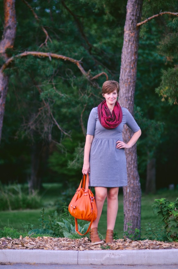 orange purse gray dress